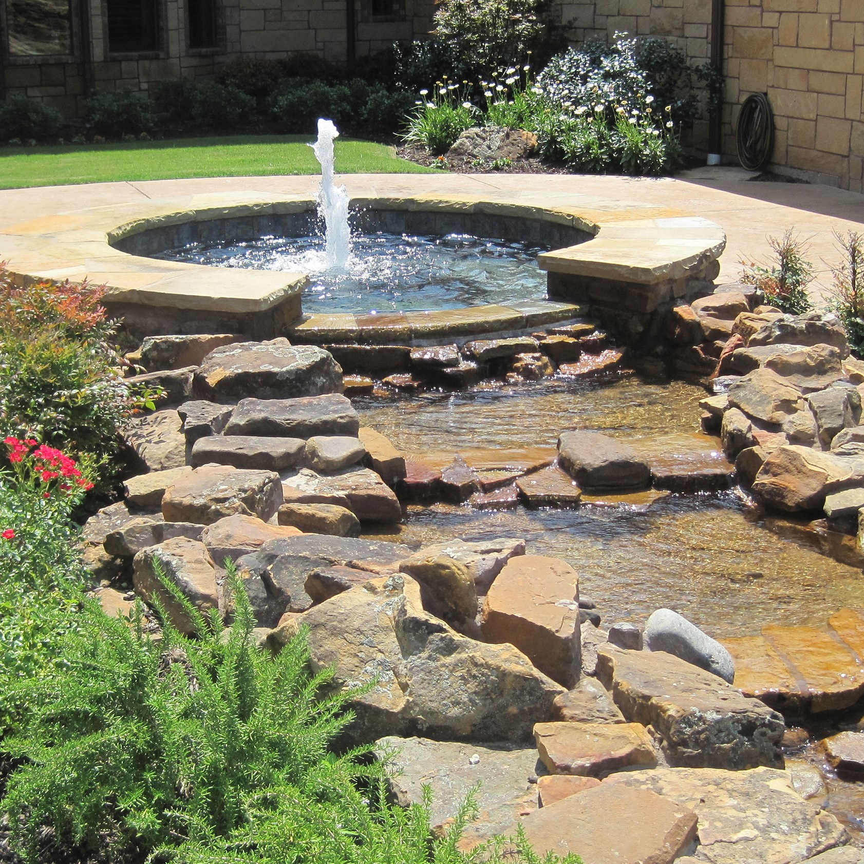 pool services for fountain and rock area in home.
