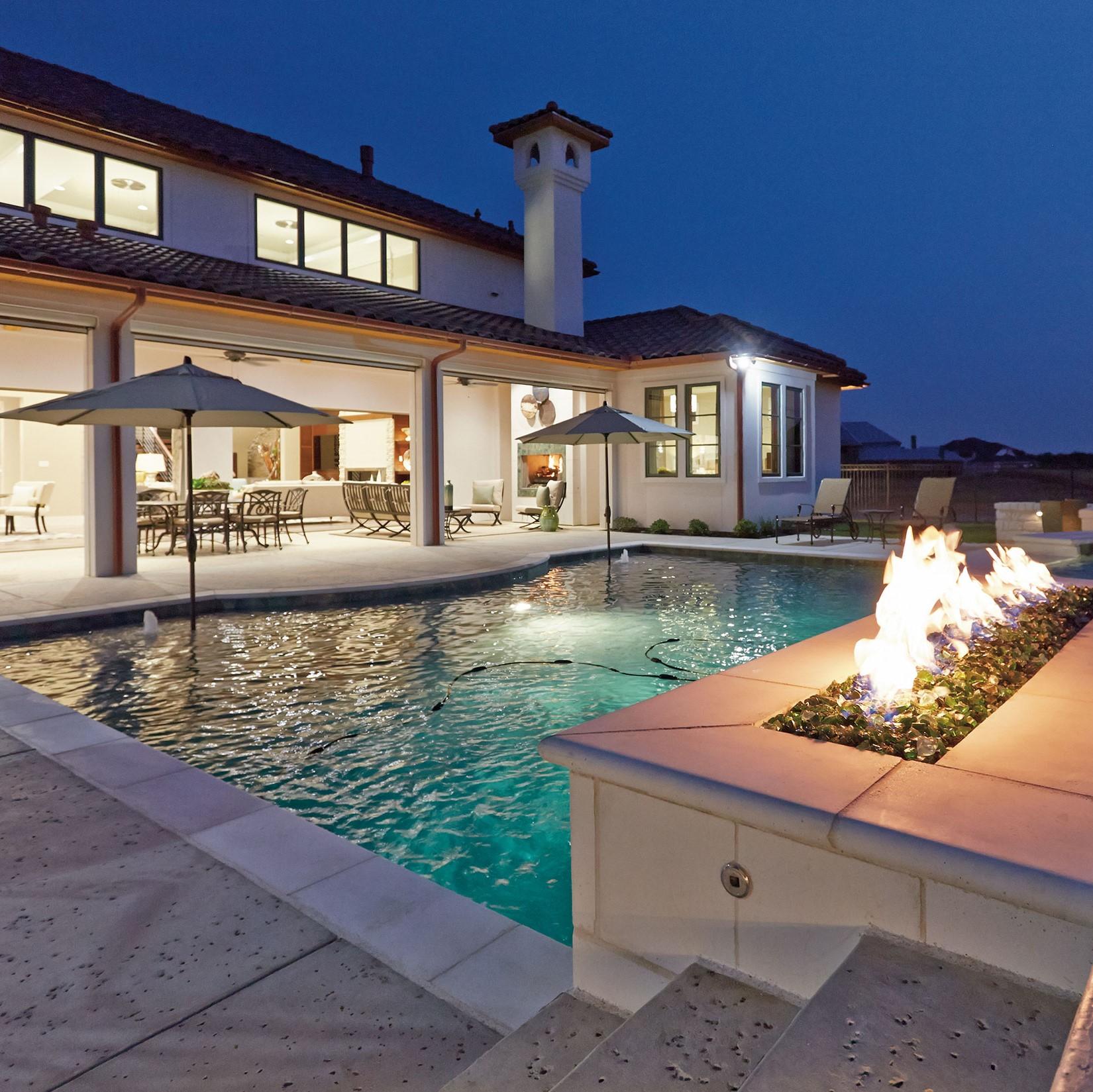 custom pool build with fireplace