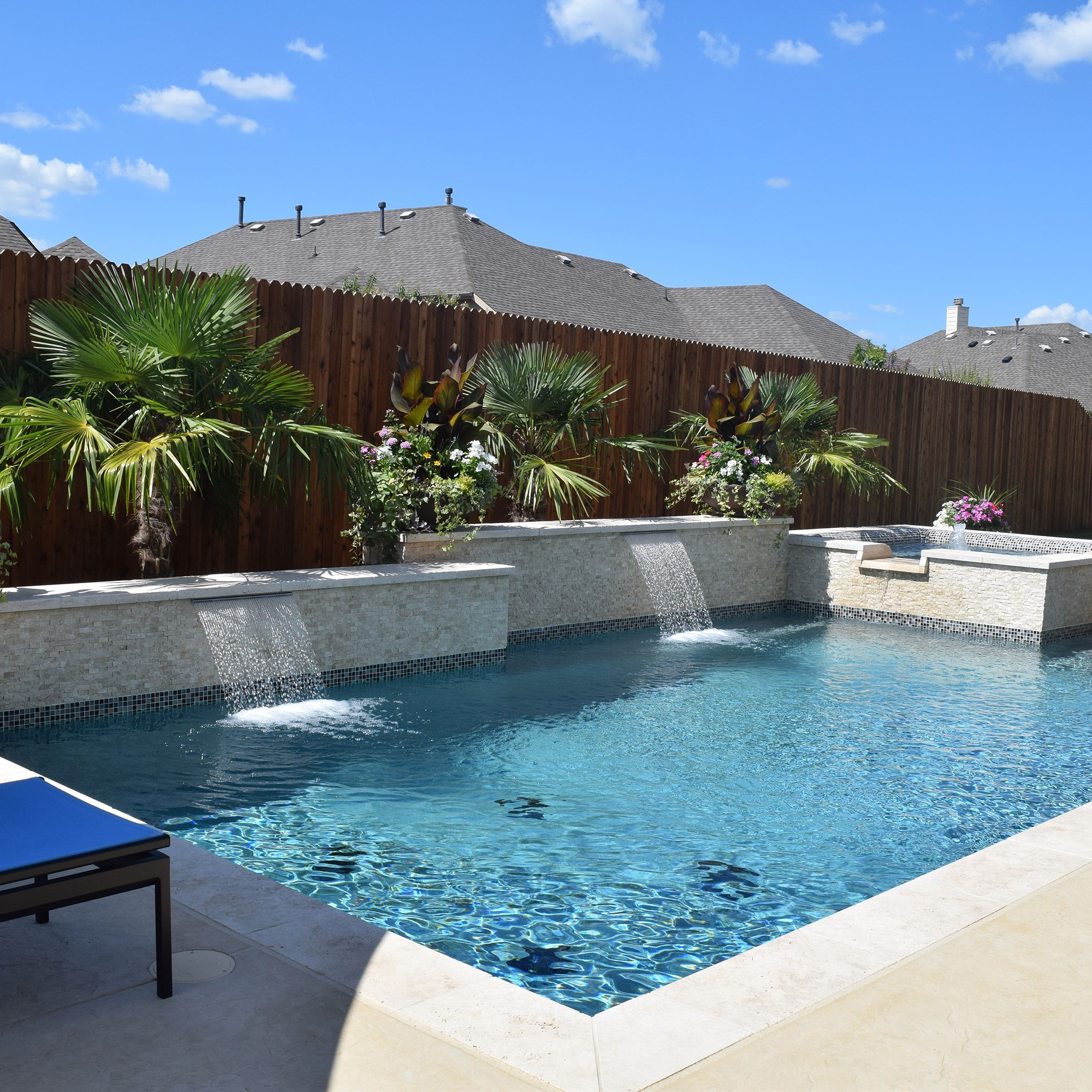 new pool installation with waterfalls